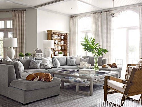A big family room demands a big sectional, one with enough space for basset hounds Okie and Maggie to sack out. It's covered in plush Glant Island chenille, in one of dozens of shades of gray designer Marshall Watson used throughout the Naples, Florida, house. The cool palette counterbalances the bright light that pours through 12-foot-high windows. - HouseBeautiful.com