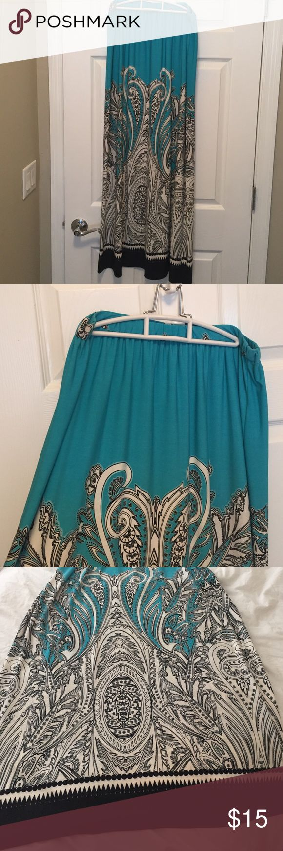 Teal maxi skirt with white and black design Maxi skirt with pretty black and white design. Elastic waist band. Size M. Very Flowy and comfortable fabric. No stains, tears or snags. Make an offer! Cute with a black or white top! Kelly & Diane Skirts Maxi