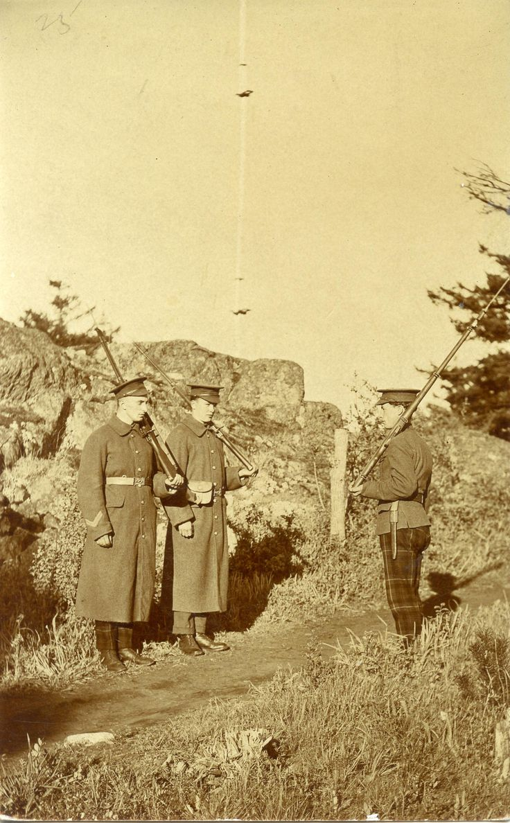 WW1. Three British soldiers on guard duty, two of them from Highland Regiments.