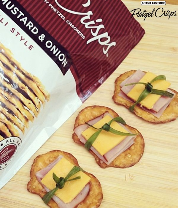 Deli ham and cheese slices on Honey Mustard and Onion Pretzel Crisps
