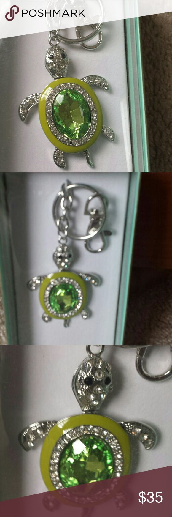 Green diamond turtle key chain Neman Marcus NWT Diamond green turtle key chain brand new in box from Neman Marcus. Gorgeous green colors. Super cute turtle and his tail moves back and forth.  Strong and sturdy great gift for yourself or special someone.  Originally $100. Neman marcus Jewelry