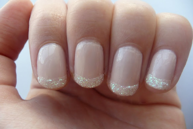 Glitter tipped French manicure - other (whiter/finer/non-iridescent) glitters could be used.  Martha Stewart has a beautiful collection.