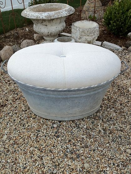 Zinc tub turned ottoman. Materials: one zinc tub, vintage European linen, vintage ticking for welt and one great upholsterer!