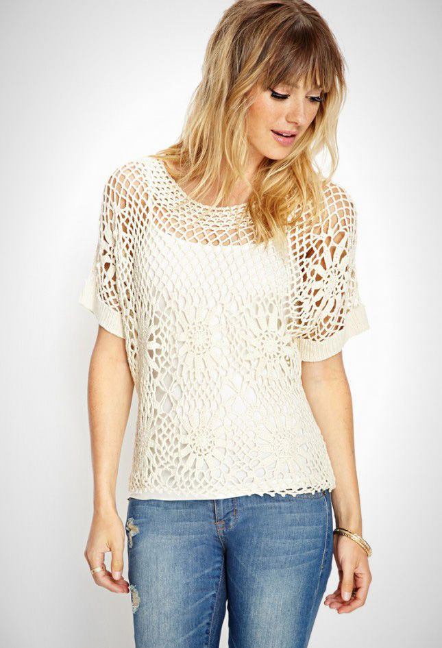 You'll look boho chic in this cream lace top.