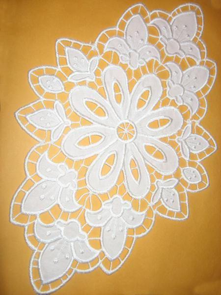 Advanced Embroidery Designs - Fleur de Lis Cutwork Doily.