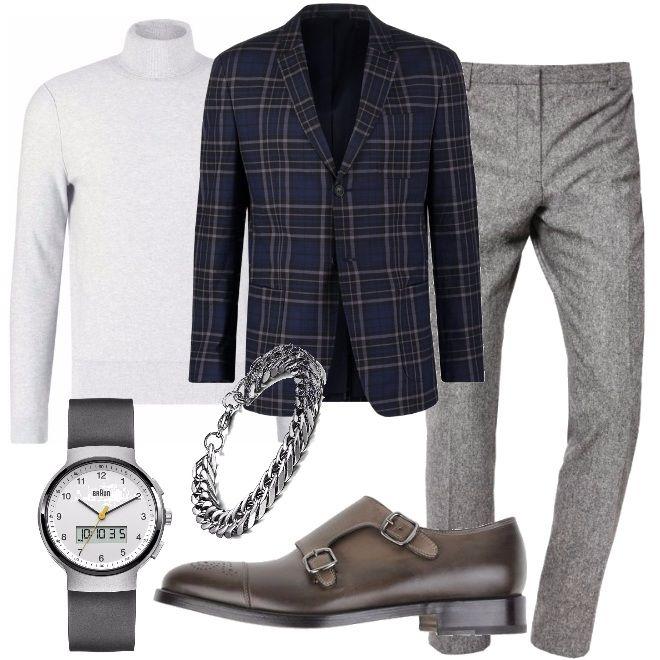 Giacca a quadri dai toni del blu, lupetto grigio pastello e pantalone da una tonalità più scura. La scarpa scelta è un mocassino color piombo in pelle, con punta tonda e fibbia laterale, orologio con cinturino in caucciù, argento e bianco e braccialetto in acciaio. Un uomo vanitoso e ricercato che ama il saper vestire e lo dimostra tutti i giorni scegliendo con estrema cura i capi e gli accessori da indossare.