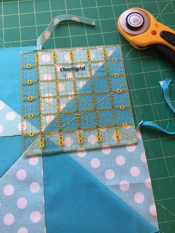 A great tip on accurately and evenly squaring up a quilt block.
