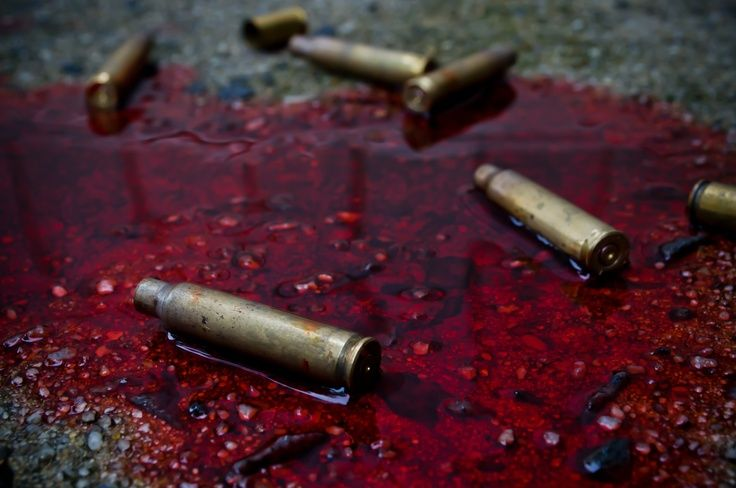 bullets in a pool of blood