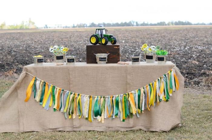 gift table: burlap table cloth, ribbon banner, toy tractor on bale of hay