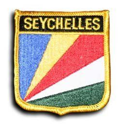"Seychelles - Country Shield Patch by flagline. $2.75. 2.5"" x 2.75"" Shield Patch. Our shield patches feature each country's flag below the name, and can be sewn on or ironed on. Actual size is approximately 2.5"" x 2.75"".. Save 30%!"