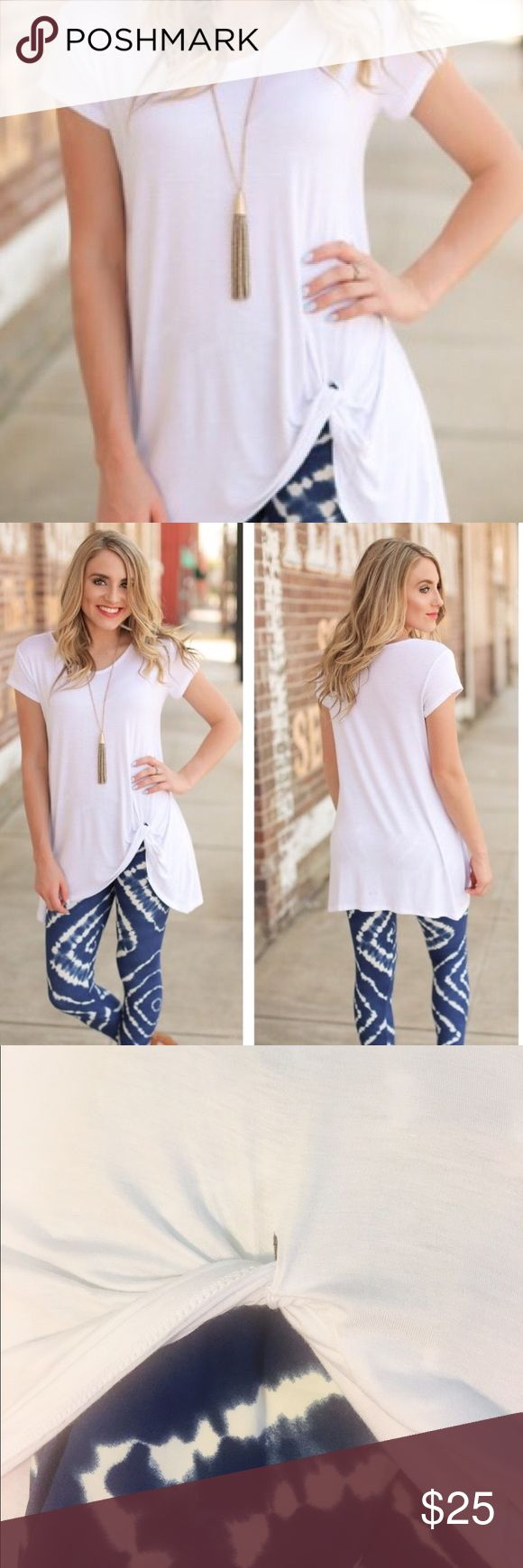 """White knot tunic, medium This simple, comfy, loose fitting white tunic is so soft you may want to sleep in it! Fabric: 95%rayon/5%spandex (Small size is for sale in separate listing. Tie die leggings are also sold in a separate listing!)  Chest: 19"""" Length: 31"""" Infinity Raine Tops Tunics"""