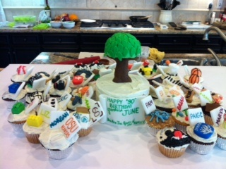 This was my 90 year old grandma's family tree cake.  Each cupcake represents a member of our family and their interests, hobbies.  The tree was a symbol of my grandma.