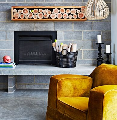 Amazing that a cinder block fireplace could look so modern and stylish. Coastal black house in Australia 7