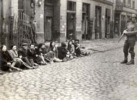 "Warsaw, Poland, SS soldiers guarding Jews who were forced out of underground bunkers during the ghetto uprising, 1943. From the Stroop Report. The Commander of the suppression of the Warsaw Ghetto Uprising, SS Major General Juergen Stroop wrote on the photograph: ""They were found even in hiding under the ground"".No record of any surviving"