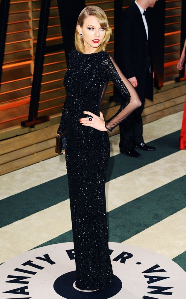 Taylor Swift stunned in this sparkly sheer black dress at the Vanity Fair Oscar's Party
