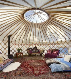 Glamping Wales Snowdonia at Graig Wen near Harlech beach. Stay in a beautiful yurt or caban in the glade with Green Traveller Best Forest Escape Award!