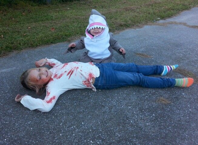 A shark and his victim. Brother sister costume duo!