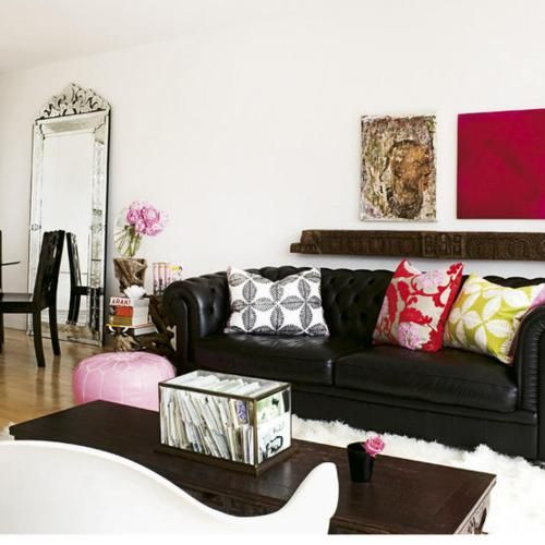 Finding ways to love the black leather sofa - part trois ... And mirror against wall idea