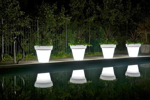 ' As we already noticed, glowing pots and planters are awesome decoration for any outdoor and even indoor space. There are some of such translucent pots and planters among simple, stylish and yet sustainable products by Rotoluxe. The company creates objects of interior design from recycled content and use low watt CFL/LED lighting to provide them with an ambient glow.
