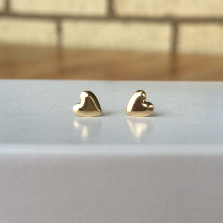 These dainty 14k solid yellow gold Heart Earrings are ultra-small; measuring 5mm. Makes the cutest earrings for both adults and kids. [ SuzanDes.com ]