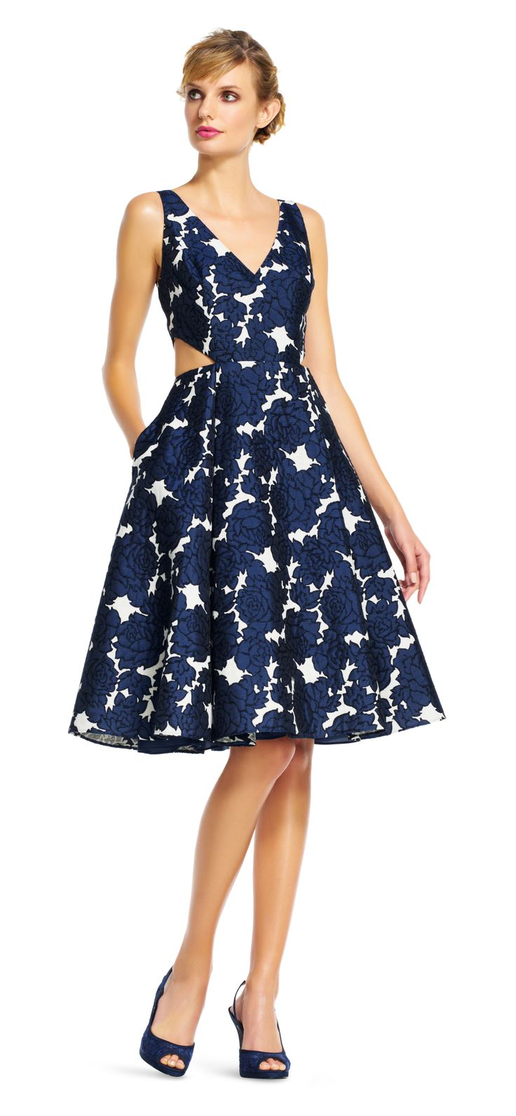 Dark and romantic florals gather on this stunning cocktail dress. Featuring cutout side, a v-neckline, and pockets, this pretty tea length dress will be a hit at your next party. This midi dress will shine paired from day to night with neutral or metallic peep toe pumps and a beaded handbag.