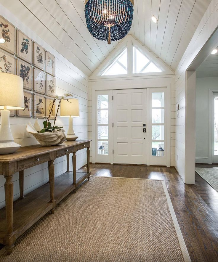 Coastal Inspired Foyer/hallway With Shiplap, Planked Ceilings/walls, Sisal  Indoor/outdoor Rug Love Te Chandelier In This Foyer.