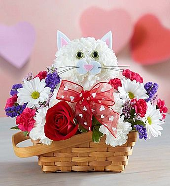 Flirty Feline™  EXCLUSIVE We've created the purr-fect surprise for someone special! Handcrafted from fresh white carnations, our cute cat arrives in a charming basket filled with a mix of hot pink mini carnations, white daisy poms and more. Holding a single romantic red rose and finished off with a sweet bow, our truly original kitten is sure to have everyone smitten!