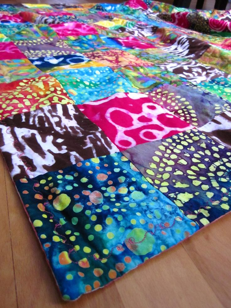 I started quilting after taking a course in batik at RISD 's apparel and textile design department.  My mom and I took the course togethe...