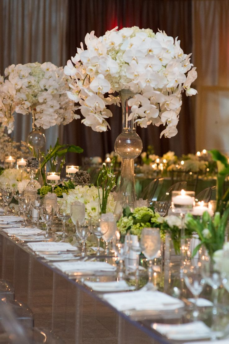 white centrepieces were oh so chic at this mandy bryant dewey seasons hotel austin: day orchid decor