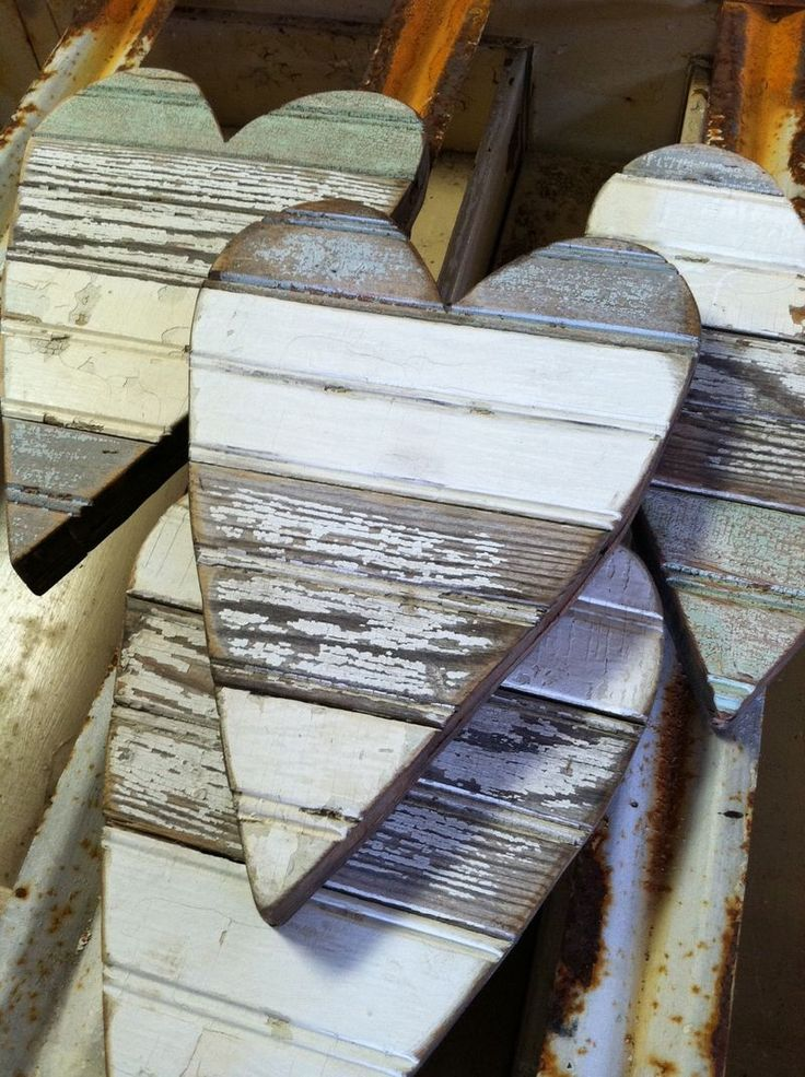 Weathered Wood Hearts: good idea for any old wood rim you can find...cut out hearts with a scroll saw. The more chippy the paint, the better!