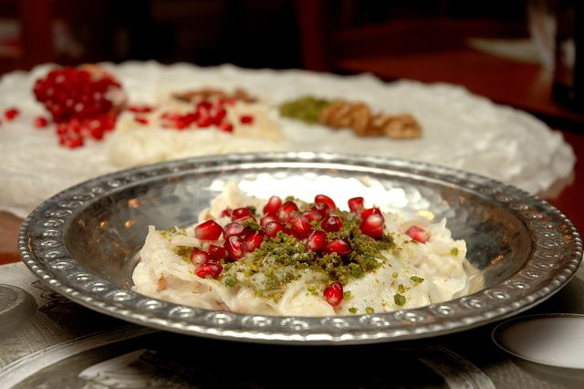 This delicate Turkish dessert is as beautiful to look at as it is to eat. White, fluffy, translucent layers of paper-thin cornstarch soaked in milk and flavored with rose water are as light as air.