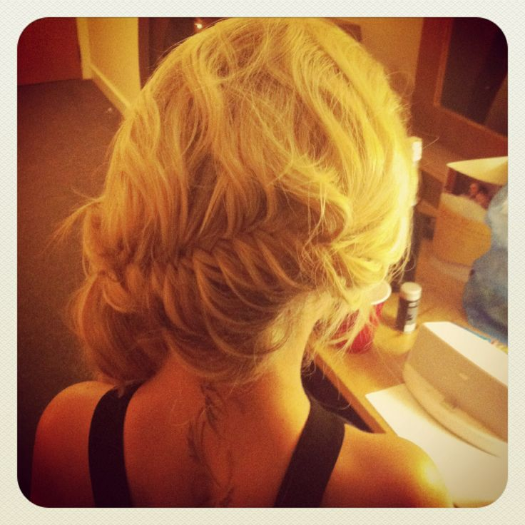 French fishtail plait gripped to one side...