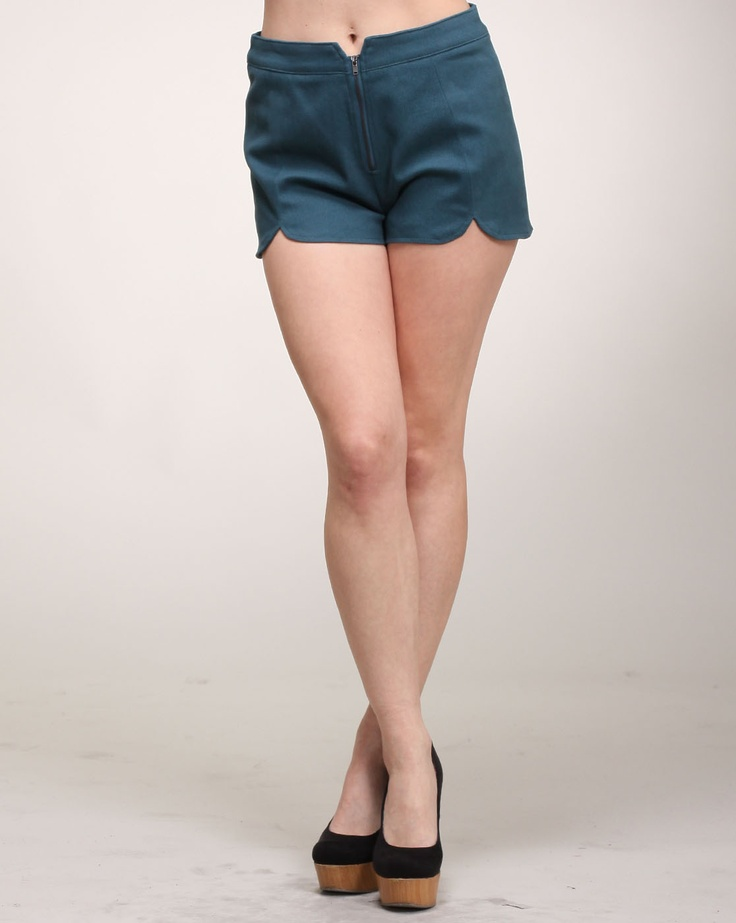 Cheryl says: The easiest way to make your shorts stand out in a crowd of other shorts is to have some special details. And nothing is cuter than a nice petal design like the one seen here. These solid teal shorts have a petal cut design on the front that is sure to spice up your look. They also feature a zipper closure.