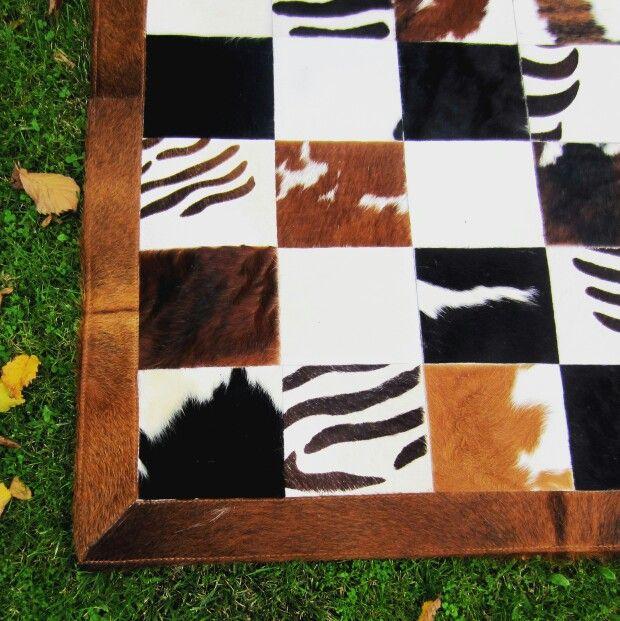 Detalle alfombra de piel con pelo patchwork.