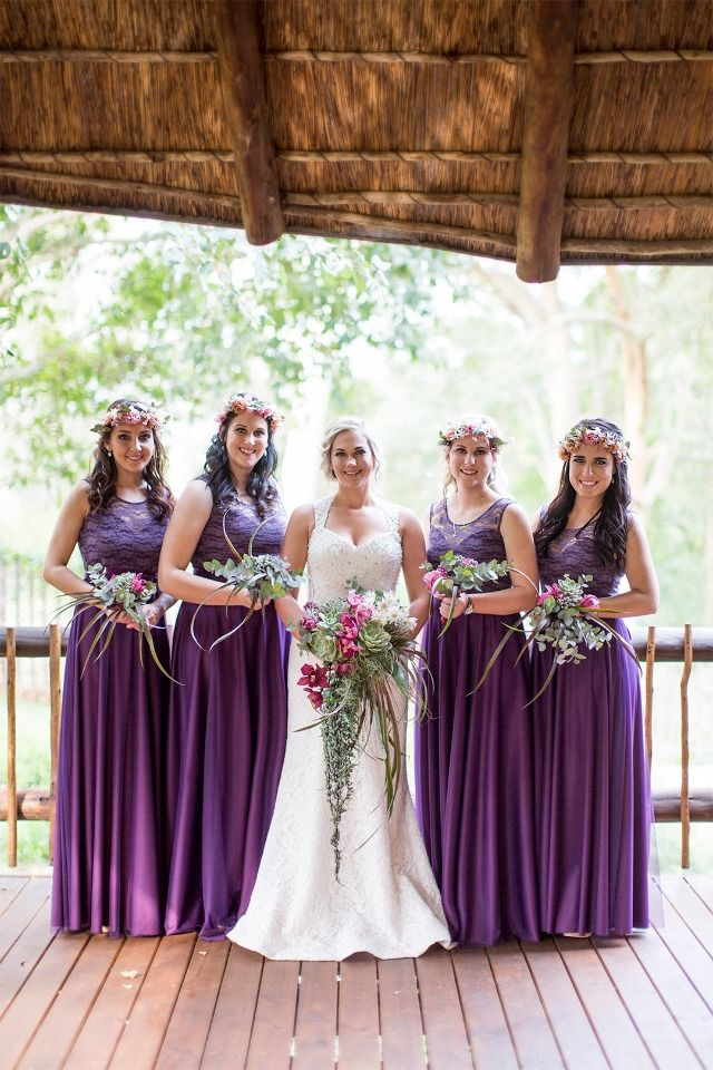 bride and her bridesmaid sin all purple