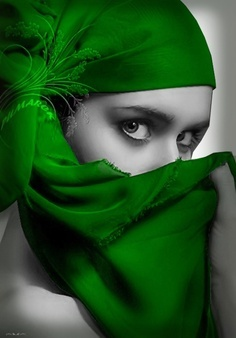 A mysterious Lady partially hidden in a draped head scarf of a gorgeous, solid green color...
