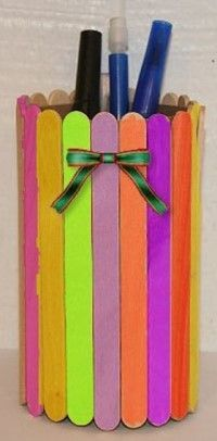 Popsicle Stick Pencil Holder - the girls made a few for daddy a few years ago.  We use colored popsicle sticks and soup cans.