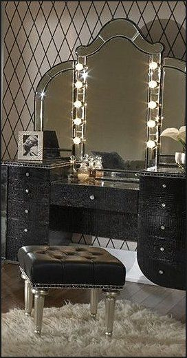 I like the triple mirror, the shape of it and that it's lighted - the rest of it I don't care for.  Usher Hollywood glamor into your home by adding this gorgeous Hollywood style lighted Vanity Set      Amini Hollywood Swank Black Vanity Set with Mirror      Enliven your bedroom with this dazzling piece of  furniture breathing with old-Hollywood style