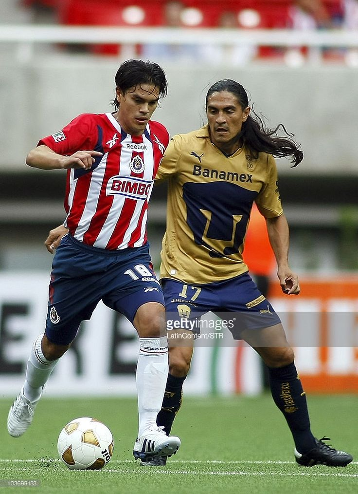 Xavier Ivan Baez (L) of Chivas vies for the ball with Juan Francisco Palencia (R) of Pumas during a match as part of the Apertura 2010 at Omnilife Stadium on August 27, 2010 in Guadalajara, Mexico.