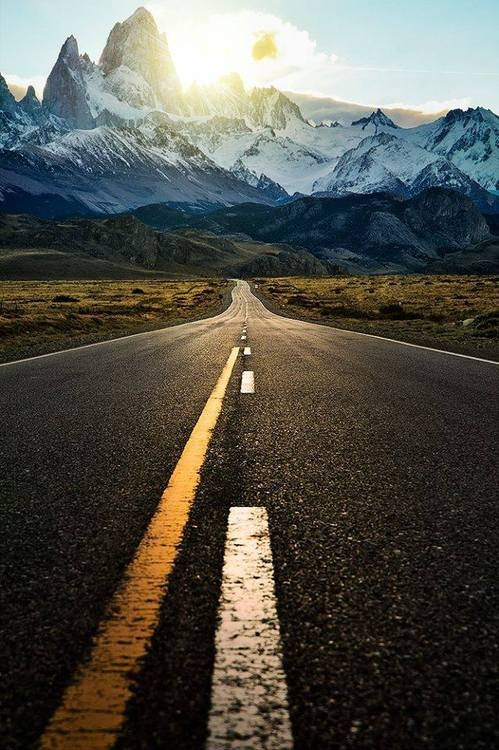 Road to new heights... love the mountainns in the background
