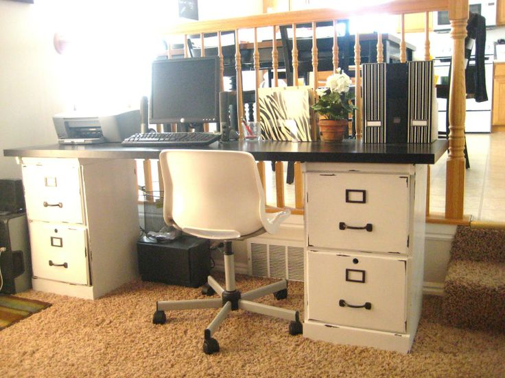 A desk made from an old door and two file cabinets.  Love the idea!  I'd probably make mine colorful.