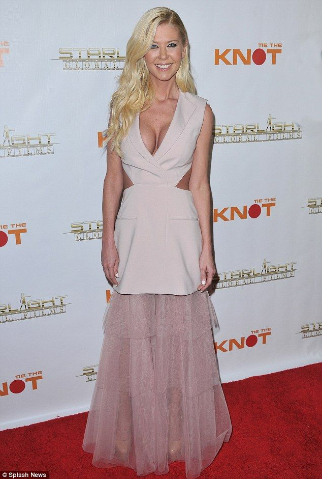 Softer look for her: Tara Reid showcased her surgically-enhanced cleavage in a surprisingly frilly frock at the Los Angeles premiere of Tie the Knot on Wednesday