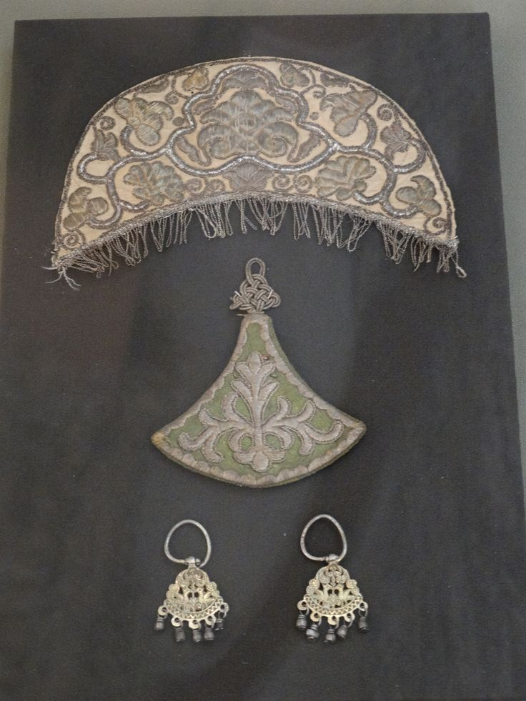 "upper: detail of female headdress with golden embroidery. middle: kosnik/nakosnik (косник) - decoration for braid. second half of the 18th century. Silk, golden and silver embroidery. lower: earrings in type ""golubtsy""(серьги-голубцы). North Russia, 18th century. Copper,Gilding. Traditional russian costume, russian headdress. The State Historical Museum, Moscow"