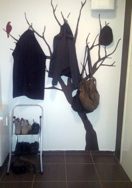 Tree coat hanger - 15 DIY: Amazing Coat Racks Projects. That works. I have a corrugated tree silhouette from Halloween that would fit fine.