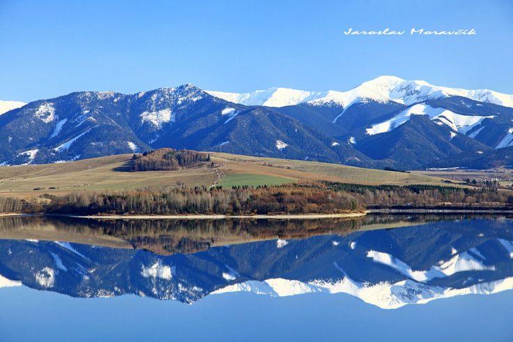 Reflection on lake Liptovska Mara in region Liptov, Slovakia