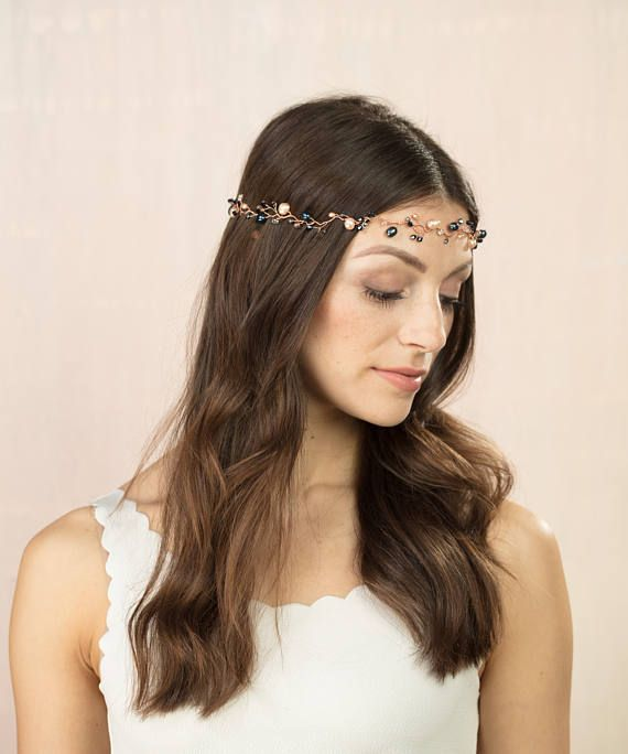 Navy and blush freshwater pearls and crystals on rose gold to create a bridal hair garland thats both delicate and striking. This headdress is perfect for brides looking for wilder, more boho look and looks great on the forehead but can also be worn higher or plaited through the hair. You can also pick the colours to suit your day, we are all about bespoke here