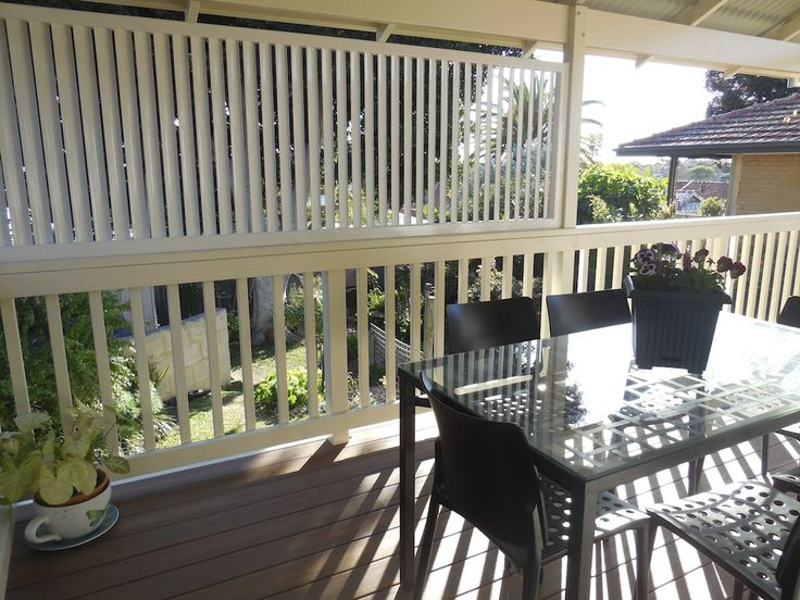 Timber balcony with balustrade and composite decking by Castlegate Home Improvements Perth