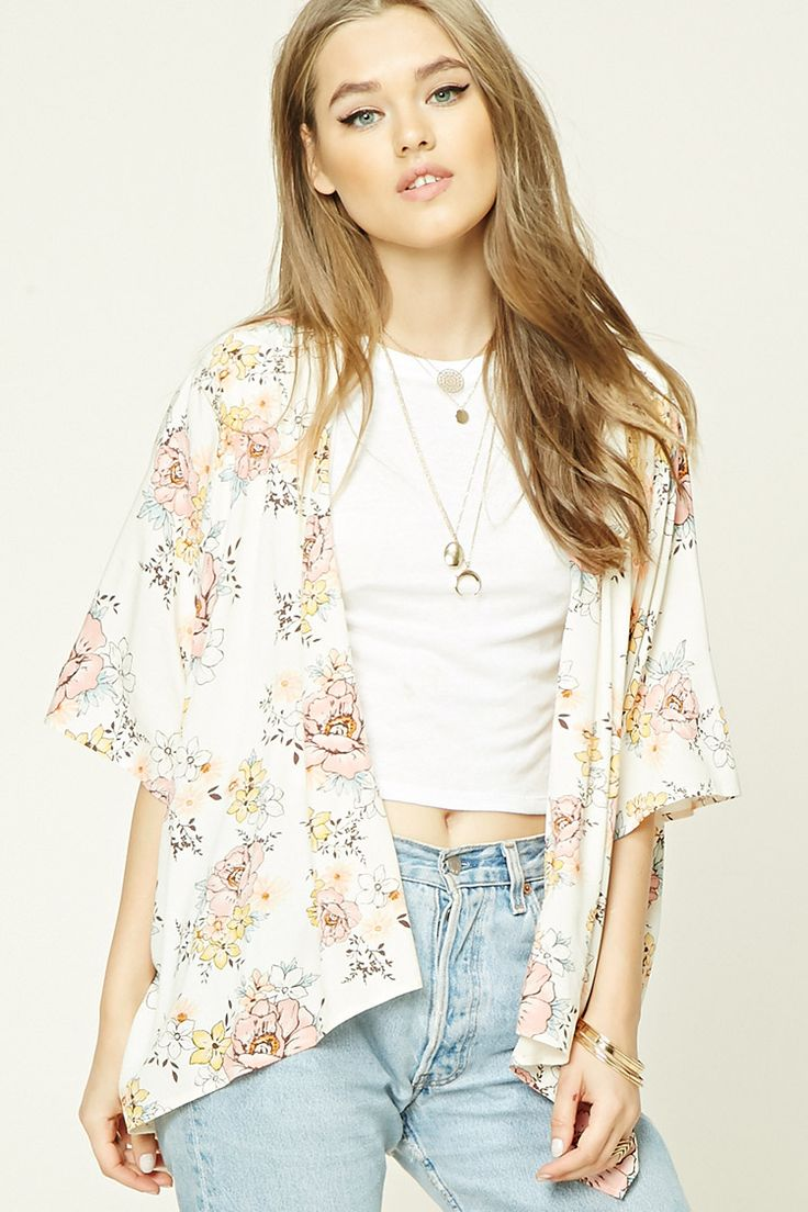 A woven kimono featuring an allover floral print, open drapey front, slit hem, and short dolman sleeves.
