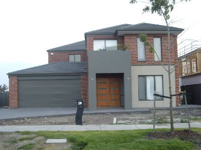 bricks - Jarrah, Charcoal roof and then everything woodland grey - gutters, fascia, windows, downpipes, garage door and portico render. Render around the study is Dune.