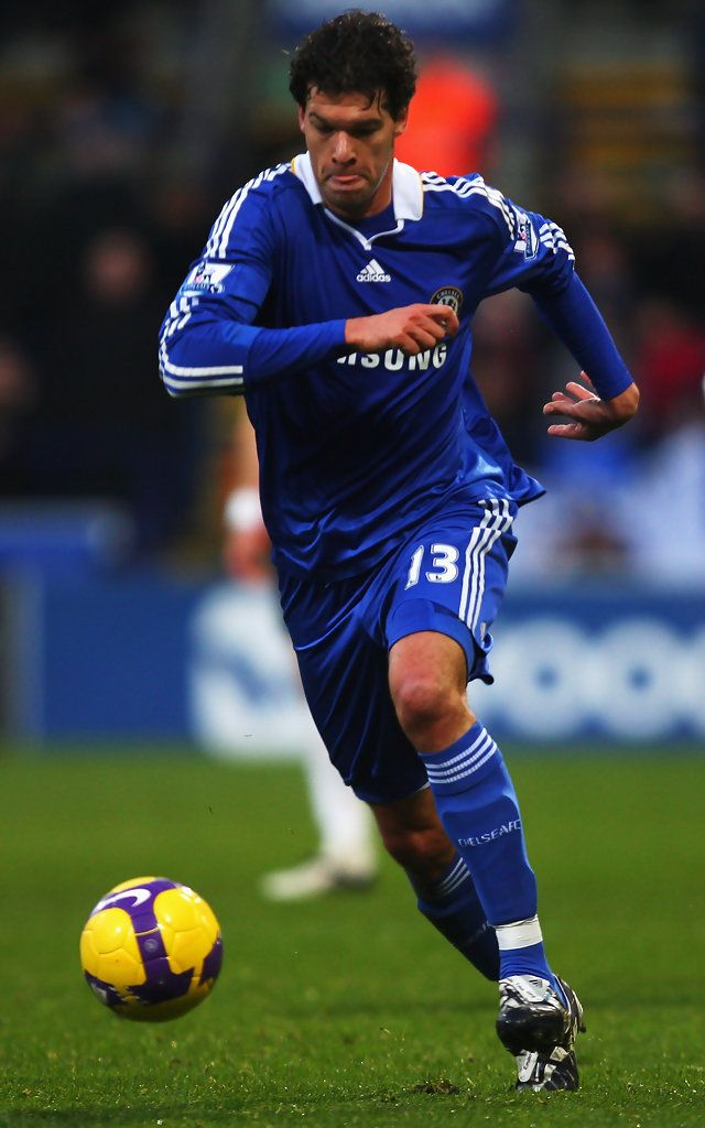 Michael Ballack of Chelsea runs with the ball